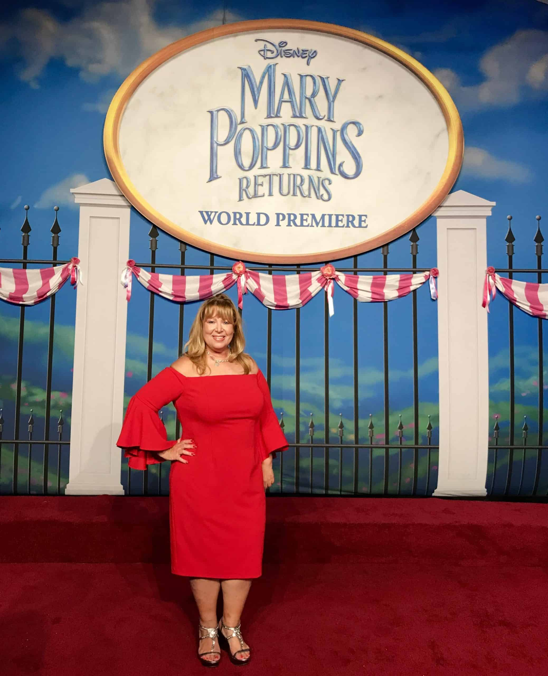 Myrah in front of Disney Mary Poppins Returns sign