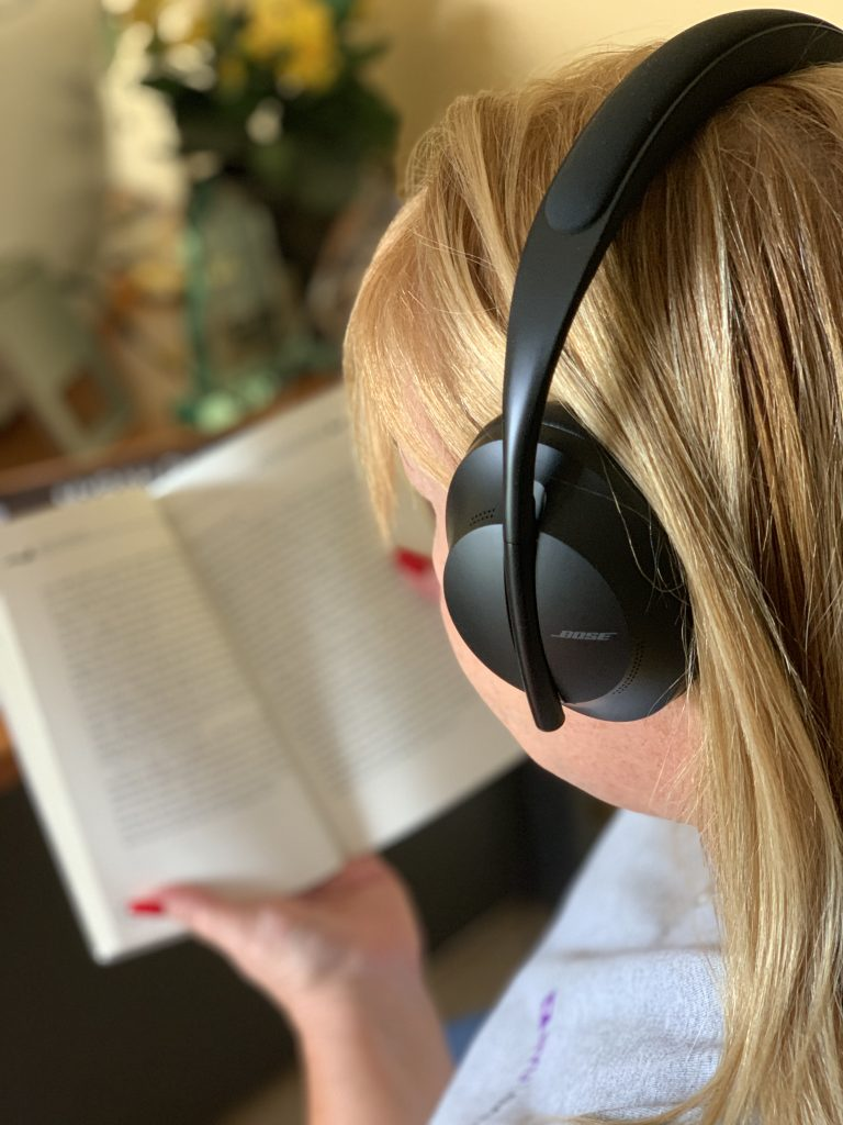 Reading and listening to music with Bose Noise Cancelling Headphones 700