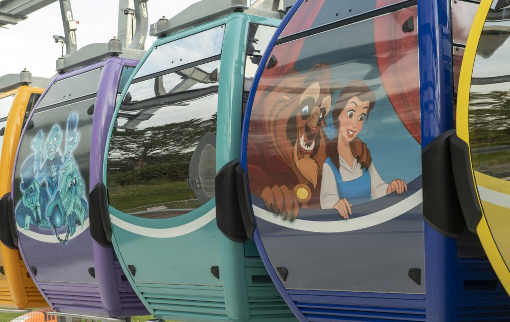 Disney Skyliner Gondolas with a graphic of Belle
