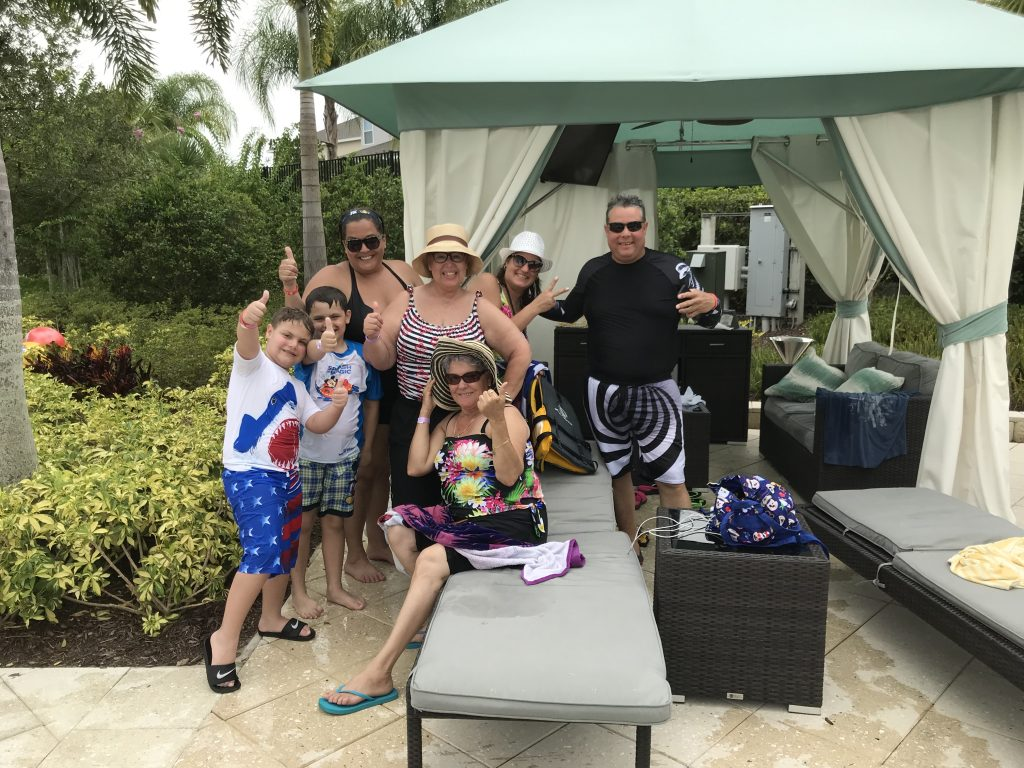 People in Encore Resort Cabana