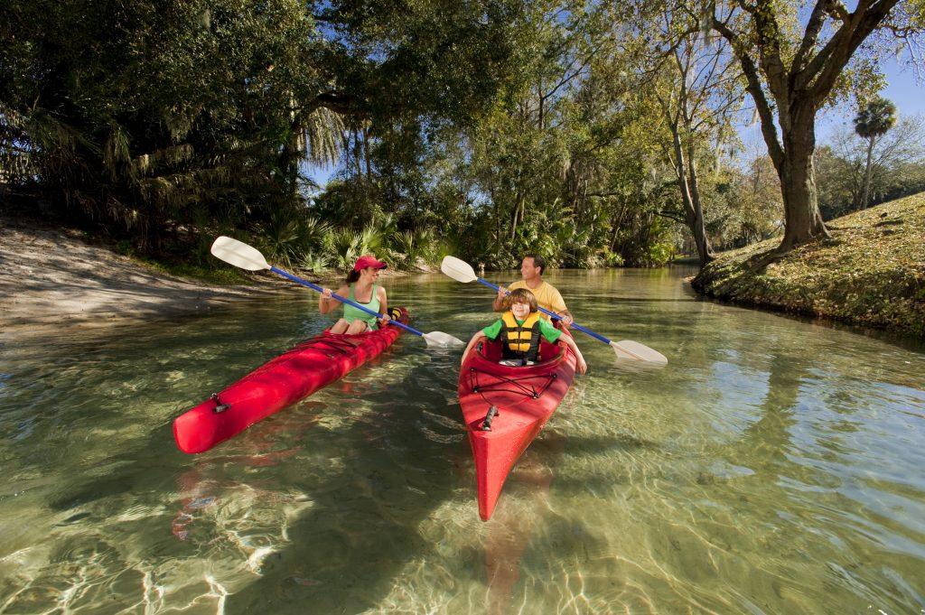 Family kayaking at Wekiva state park Florida