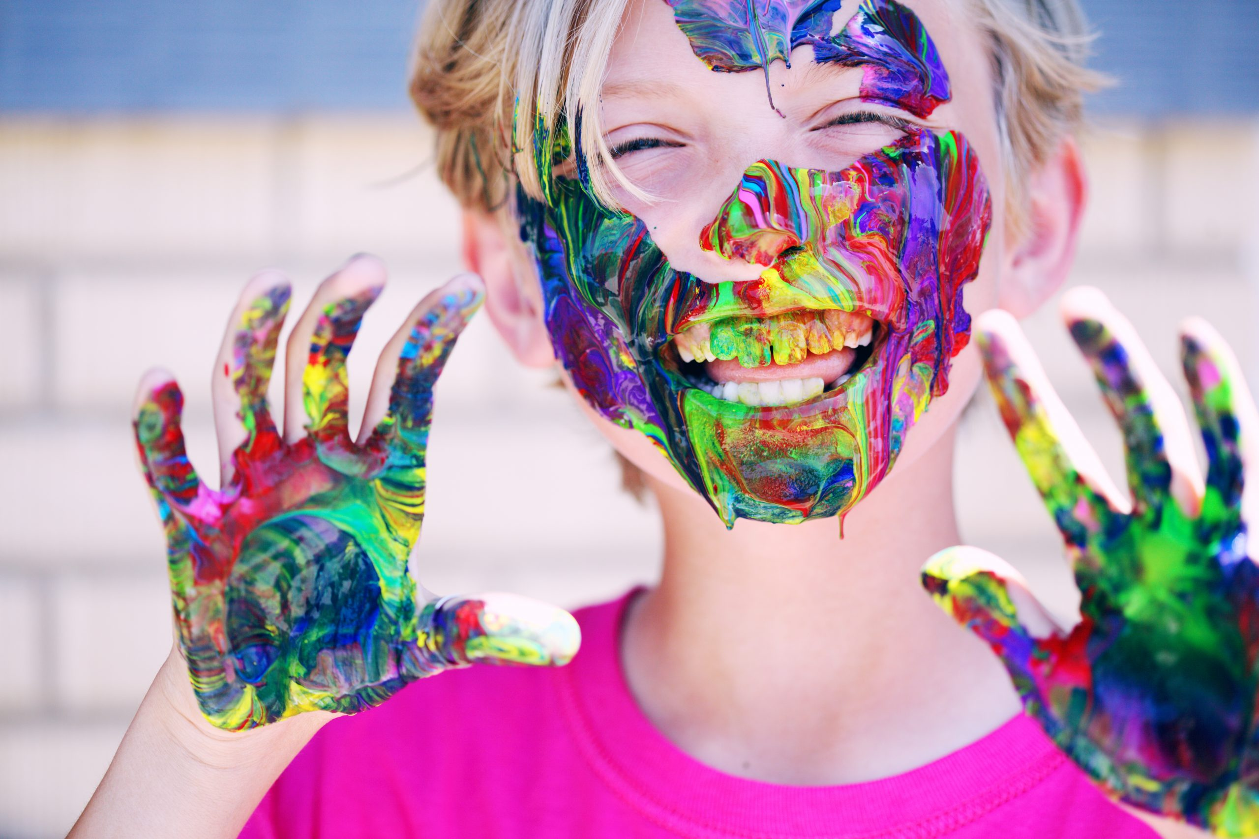 Boy With Paints on His Hands and Face scaled - 13 Fun Family Activities at Home For Everyone